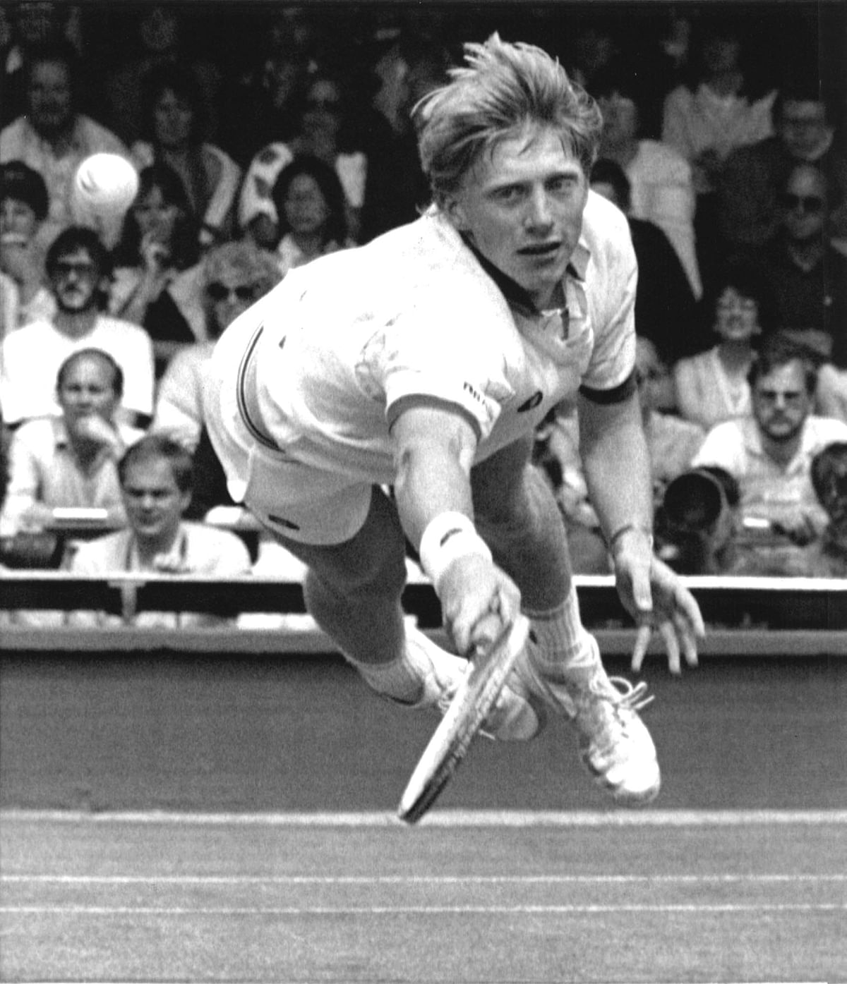 In this July 1, 1985 file photo, Boris Becker, of West Germany, dives to make a return from his opponent Joakim Nystrom, of Sweden, in the men's singles third round play at the All England Lawn Tennis Championships in Wimbledon. (Photo: AP)<a></a>