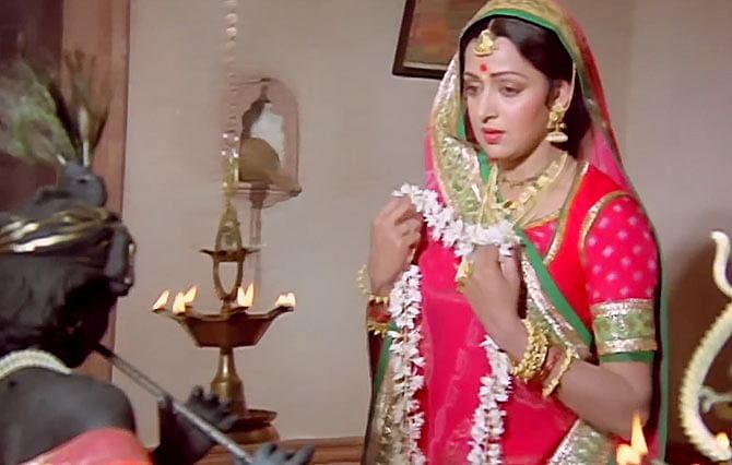 Hema Malini prays to lord Krishna in a scene from <i>Meera</i> (1979)