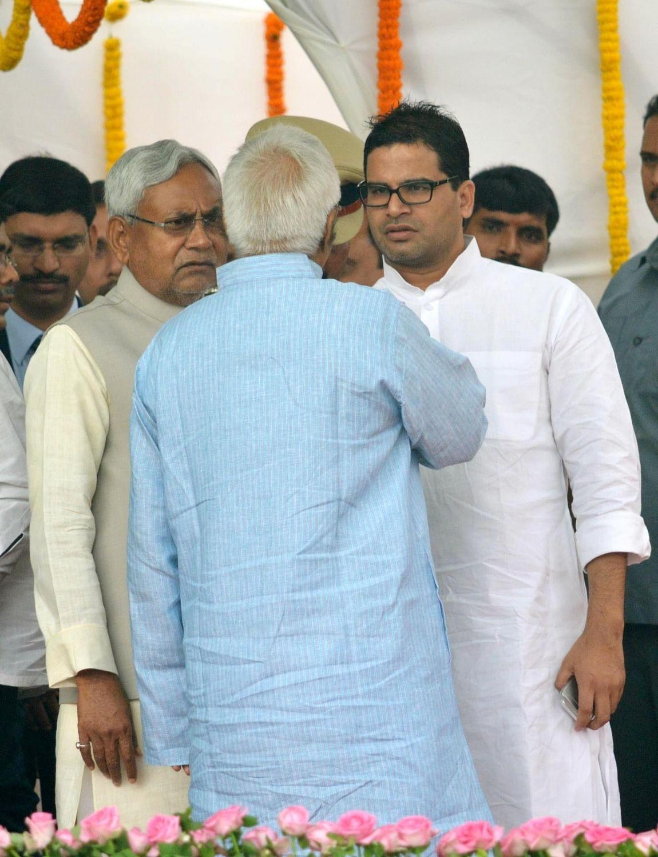 JD-U leader Nitish Kumar and RJD chief Lalu Prasad Yadav with poll strategist Prashant Kishore. (Photo: IANS)