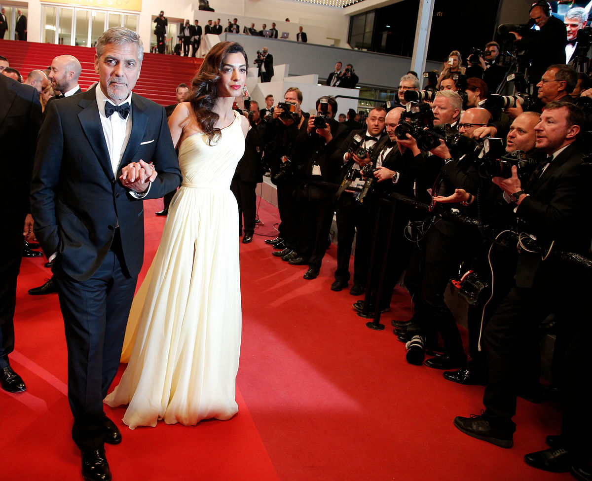 George Clooney and Amal Clooney on the red carpet in Cannes. (Photo: AP)