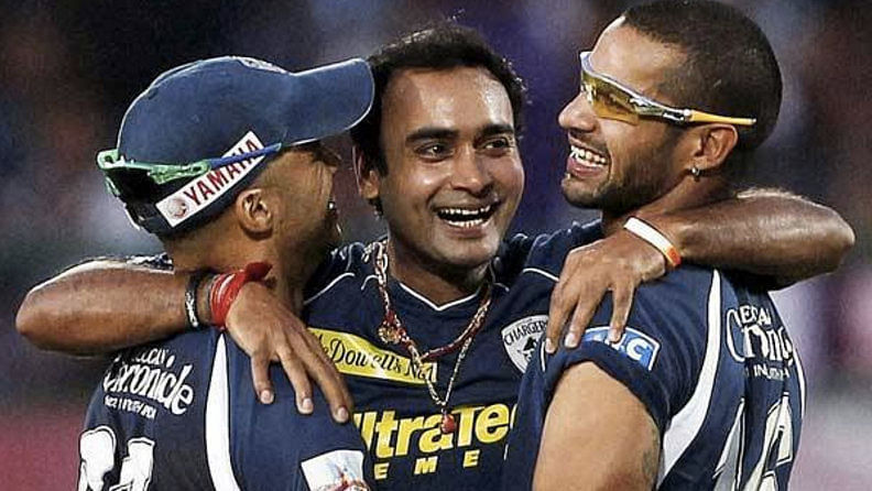 Amit Mishra celebrates the hat-trick with his teammates.