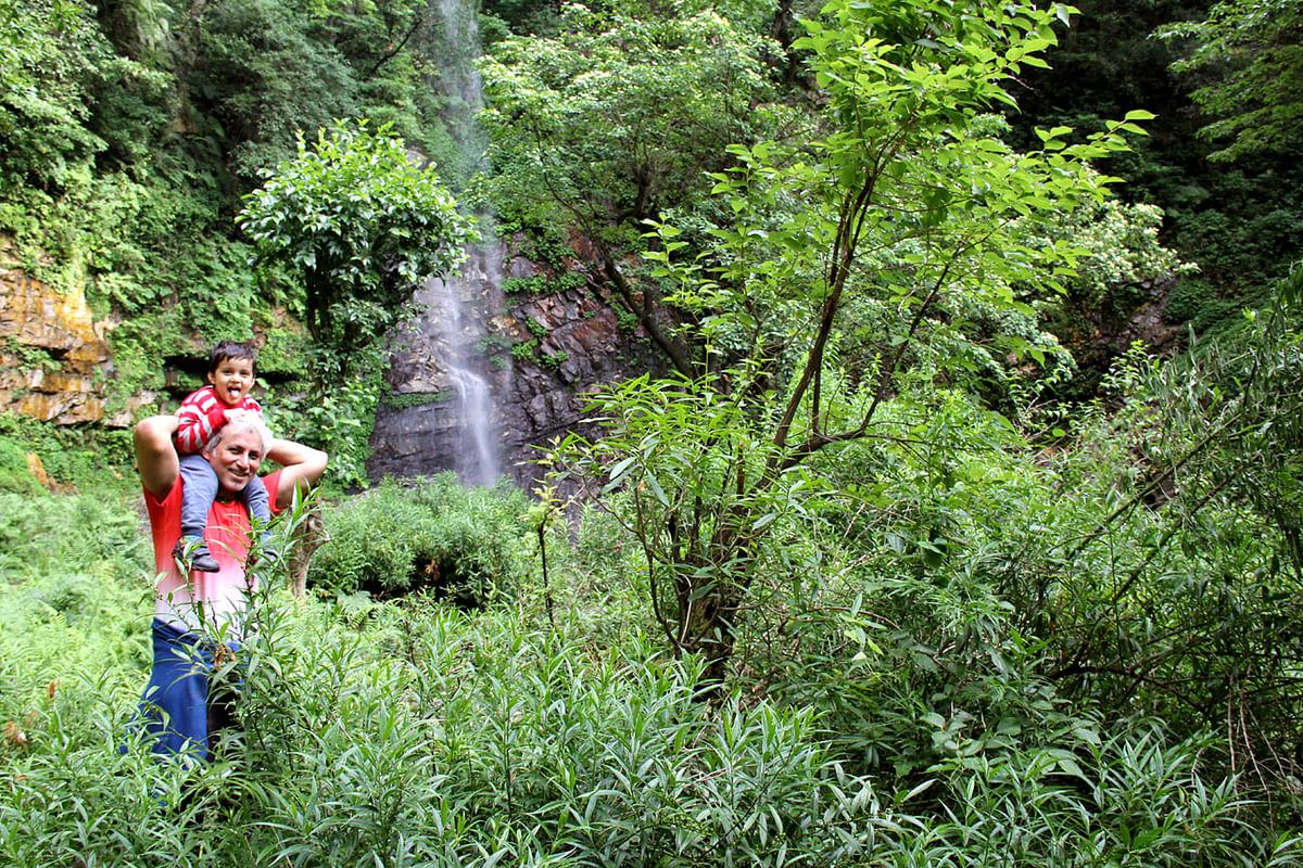 Kazuo trekking to the waterfall with dad. (Photo Courtesy: Sahar Zaman)