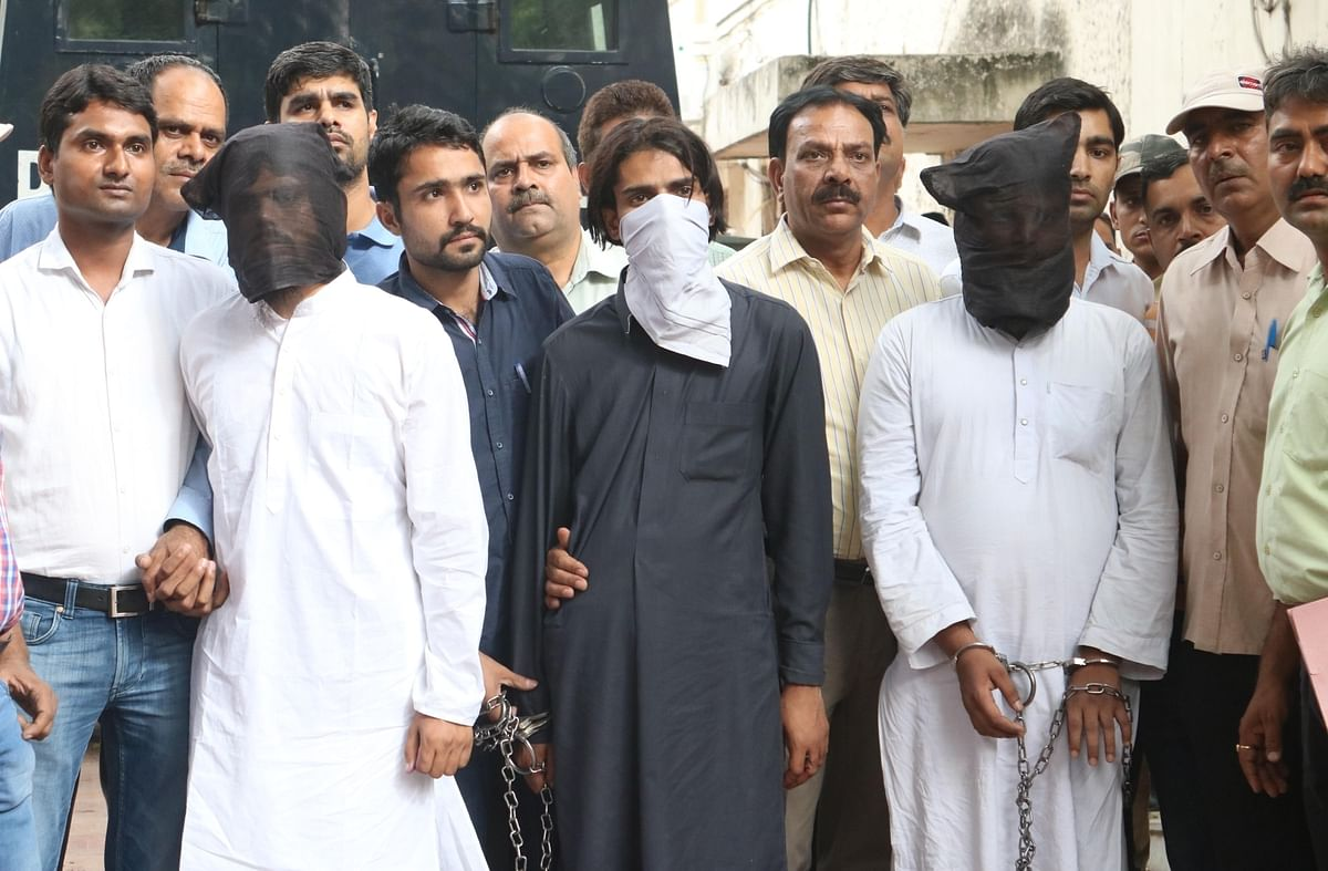 The three Jaish-e-Mohammed (JeM) suspects who were arrested for planning a terror attack in Delhi after being produced at Patiala House Court. (Photo: IANS)