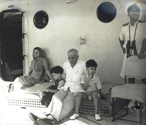 "Jawaharlal Nehru with Indira Gandhi, Rajiv and Sanjay (Photo Courtesy: <a href=""http://www.nehrumemorial.nic.in/en/galleries/photo-gallery/category/40-jawaharlal-nehru-with-family-members.html"">Nehru Memorial Museum and Library</a>)"