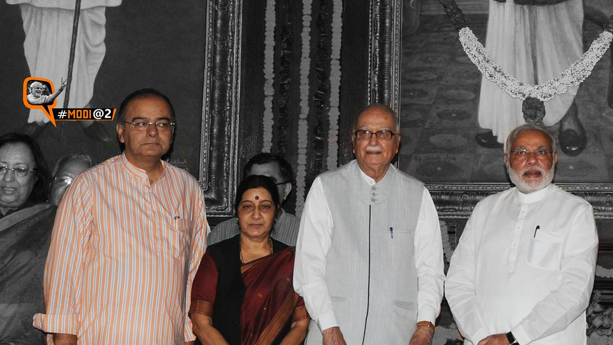 Prime Minister Modi with ministers Arun Jaitley and Sushma Swaraj, and LK Advani. (Photo: altered by <b>The Quint</b>)