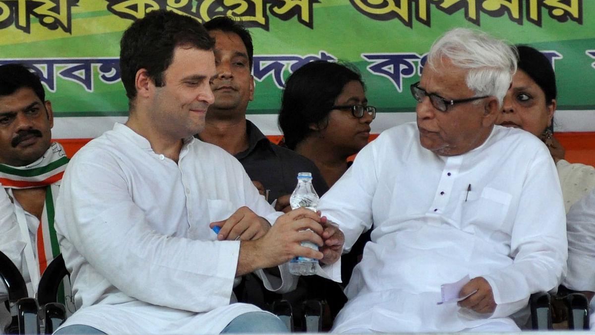 Congress Vice-President Rahul Gandhi and former West Bengal Chief Minister Buddhadeb Bhattacharya during a Congress-CPI(M)  rally in Kolkata on April 27, 2016. (Photo: Kuntal Chakrabarty/IANS)