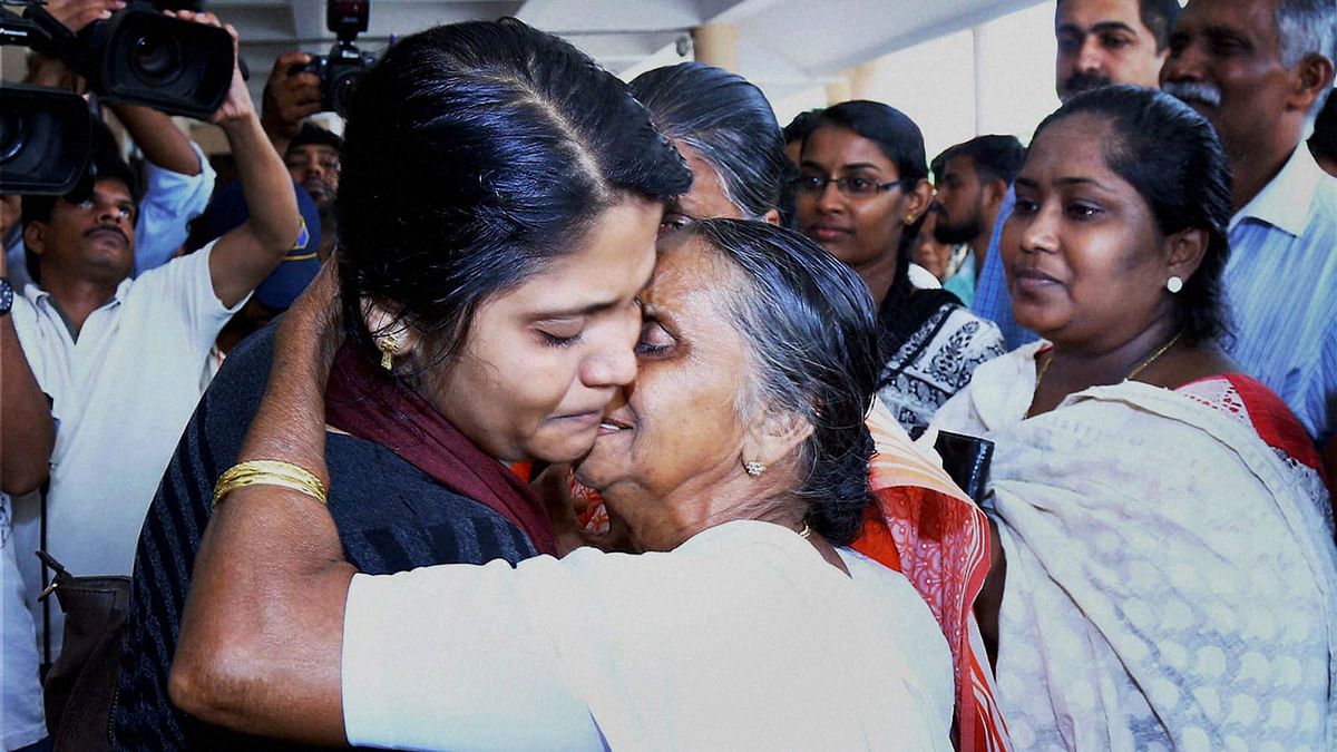 The first batch of 18 Keralites, evacuated from Libya, uniting with their families and relatives on their arrival at Kochi International Airport on Thursday. (Photo: PTI)
