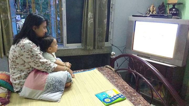 Watching cartoon shows with my son. (Photo Courtesy: Runa Mukherjee Parikh)