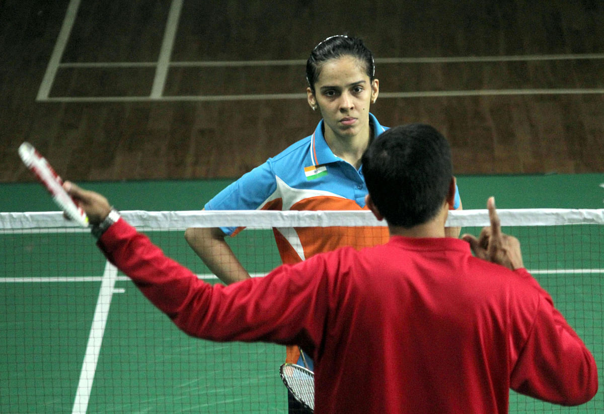 Saina Nehwal with coach Vimal Kumar at a training session in Bangalore in July 2015. (Photo: IANS)