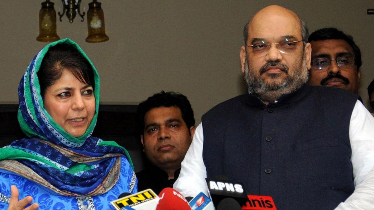 File photo of PDP chief Mehbooba Mufti and BJP chief Amit Shah and General Secretary Ram Madhav. (Photo: PTI)