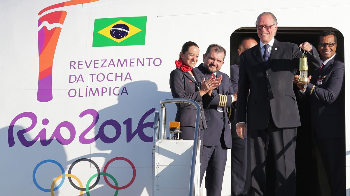 Brazilian Olympic Committee President with the lantern containing the Olympic flame  as he deplanes in Brasilia, Brazil. It was flown inside a small lantern on a special flight from the Swiss city of Geneva to Brasilia. (Photo: AP)
