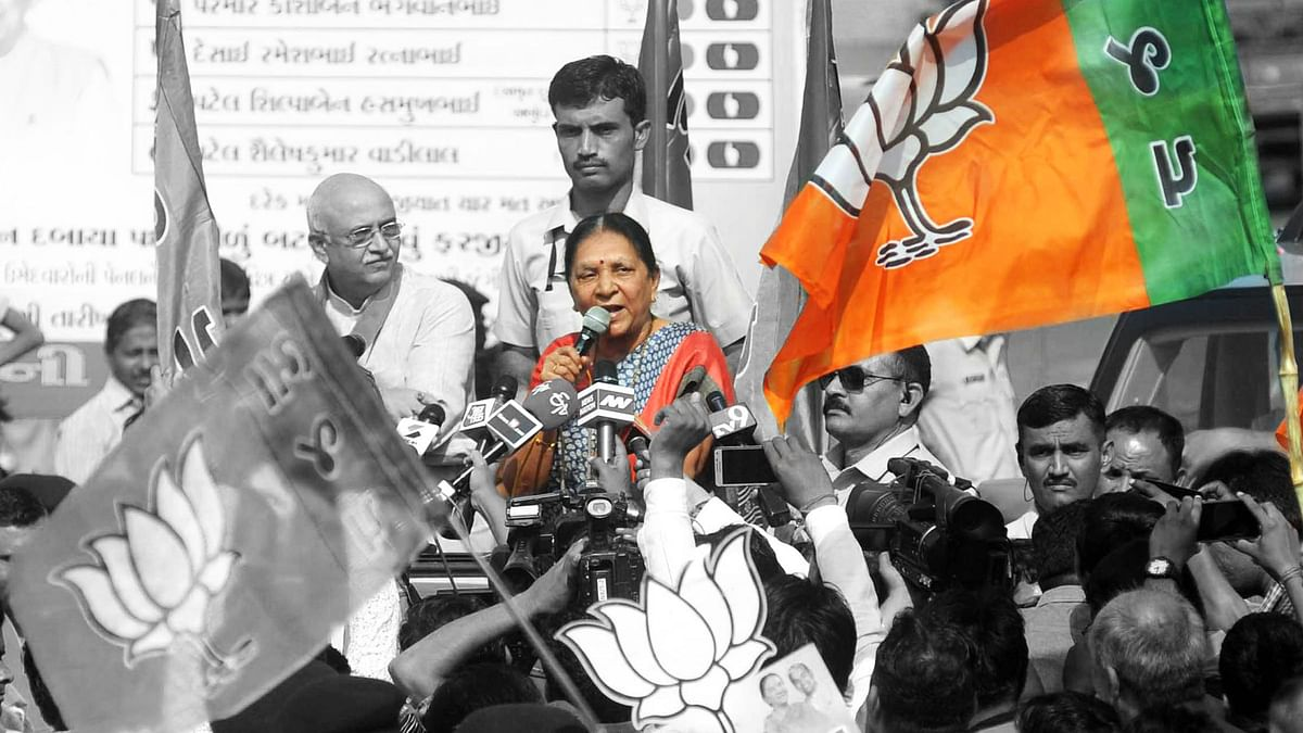 Gujarat Chief Minister Anandiben Patel at a road show in Ahmedabad on 17 November 2015. (Photo: IANS/ Altered by <b>The Quint</b>)