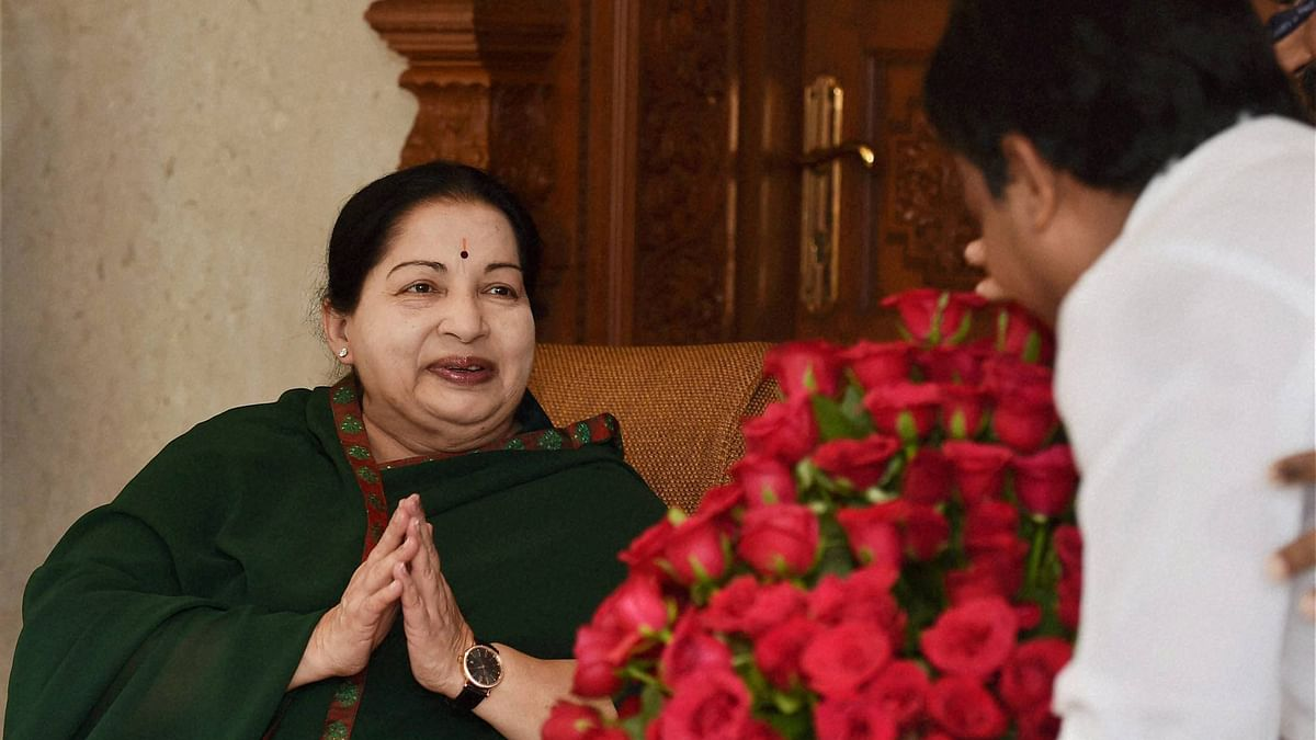 Tamil Nadu Chief Minister and AIADMK Supremo J Jayalalithaa is greeted by a party cadre after the party's win in the state Assembly polls, in Chennai on Thursday. (Photo: PTI)