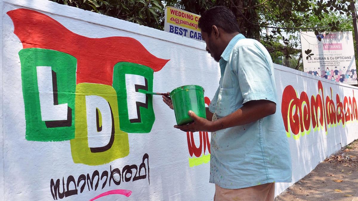 An artist makes graffiti of Left Democratic Front (LDF) in Kochi ahead of Kerala assembly polls. (Photo: IANS)