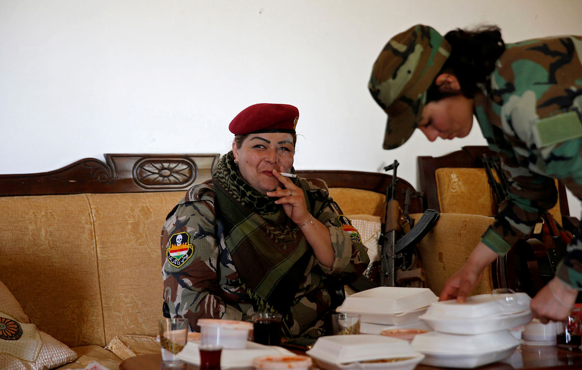 Iraqi Kurdish female fighter Haseba Nauzad, 24, smokes a cigarette after having lunch at a site near the frontline of the fight against Islamic State militants in Nawaran near Mosul, Iraq. (Photo: Reuters)