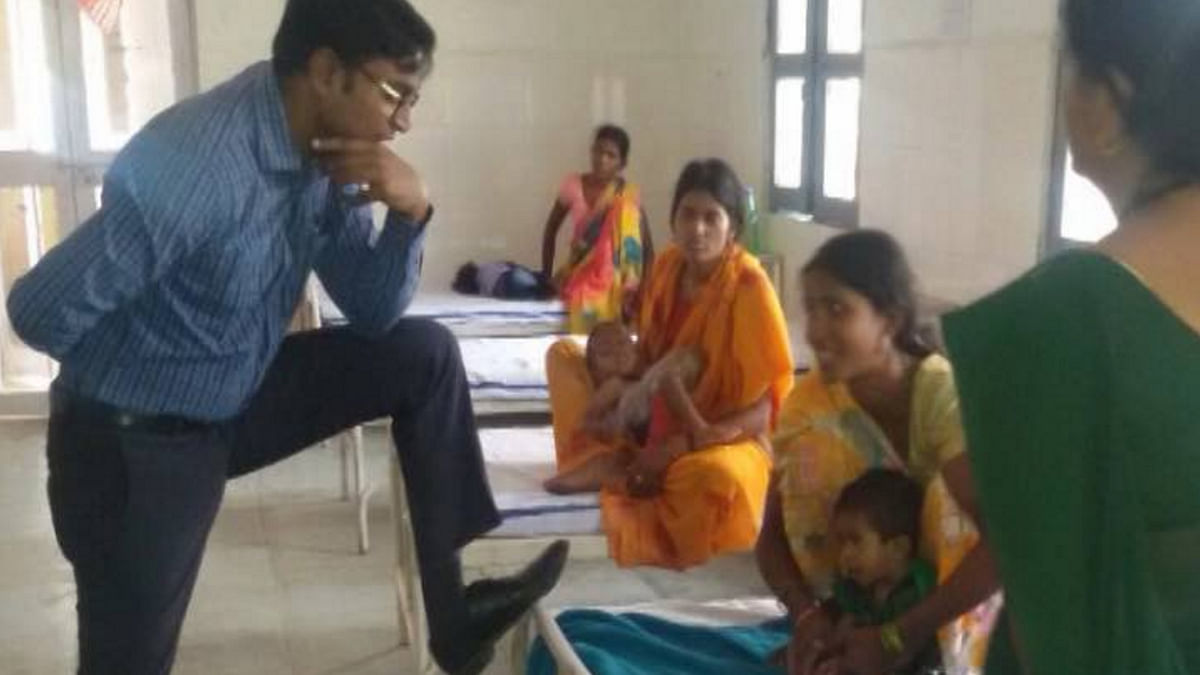 "IAS officer Jagdish Sonkar's photo went viral. (Photo Courtesy: <i><a href=""http://english.pradesh18.com/news/chhattisgarh/ias-faces-suspension-for-putting-foot-on-hospital-bed-with-lady-patient-calls-it-style-889708.html"">Pradesh 18</a></i>)"