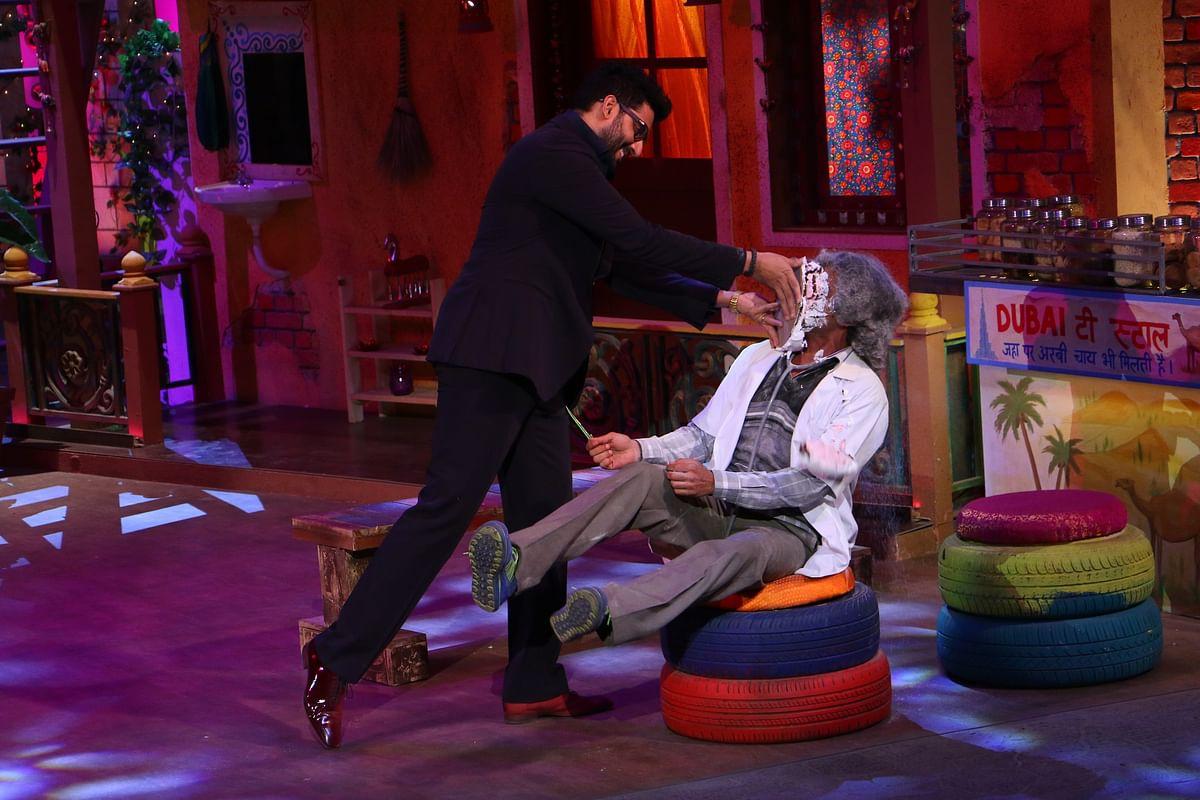 Abhishek smashing a cake on Sunil's face during the show. (Photo courtesy: Sony)