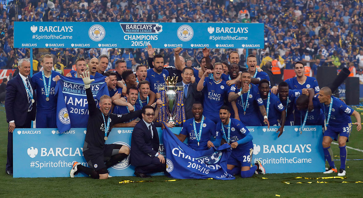 Players cheer with the trophy as Leicester City celebrate becoming the English Premier League champions at King Power stadium in Leicester on Saturday, May 7, 2016.(Photo: AP)