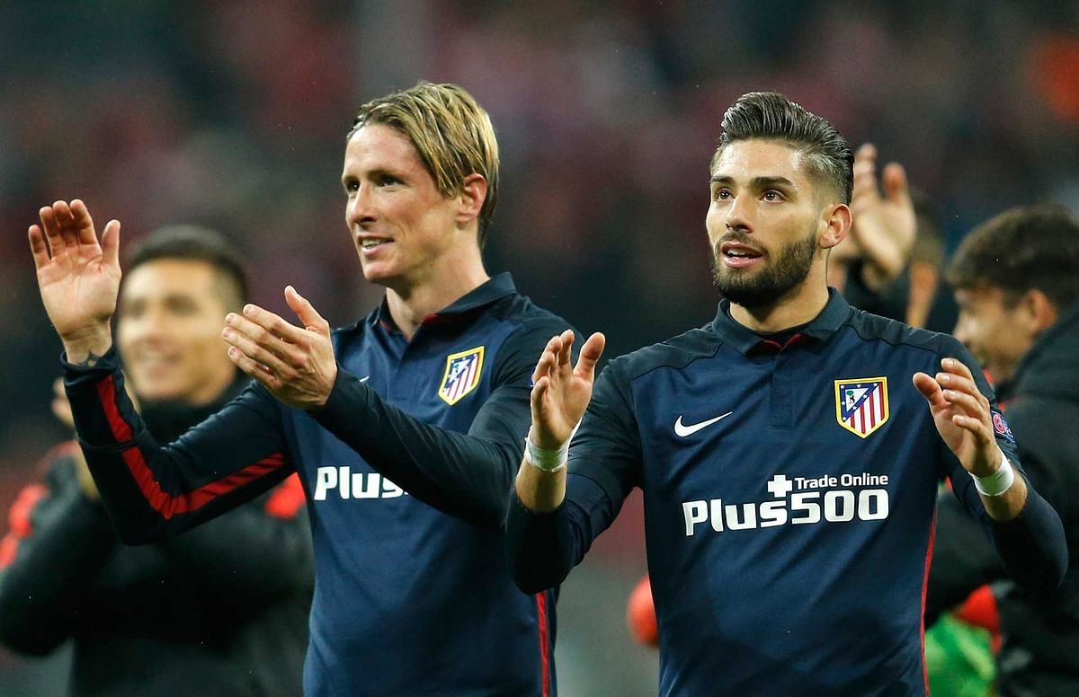 Atletico's Fernando Torres, left, celebrates with teammate Yannick Carrasco after advancing to the final. (Photo: AP)