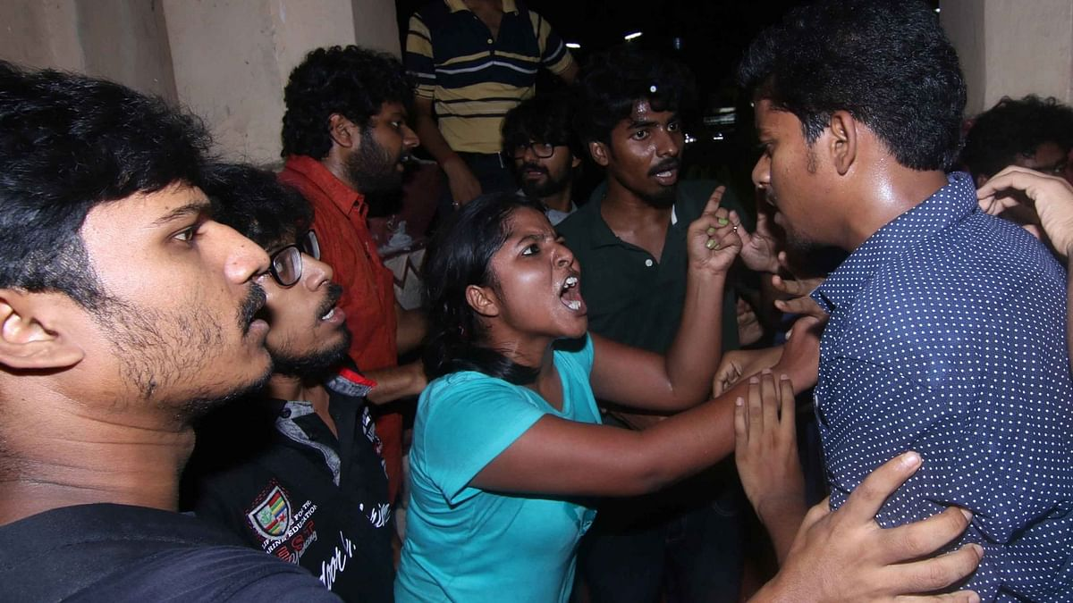 """Left and ABVP students clash with each other during the screening of the film <i>""""Buddha In A Traffic Jam""""</i> at Jadavpur University campus in Kolkata on 6 May  2016. (Photo: IANS)"""