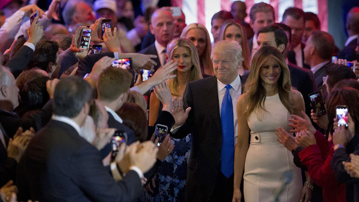 Republican presidential candidate Donald Trump is joined by his wife Melania, right, and daughter Ivanka as he greets supporters as he arrives for a primary night news conference on Tuesday, 3 May 2016, in New York. (Photo: AP)