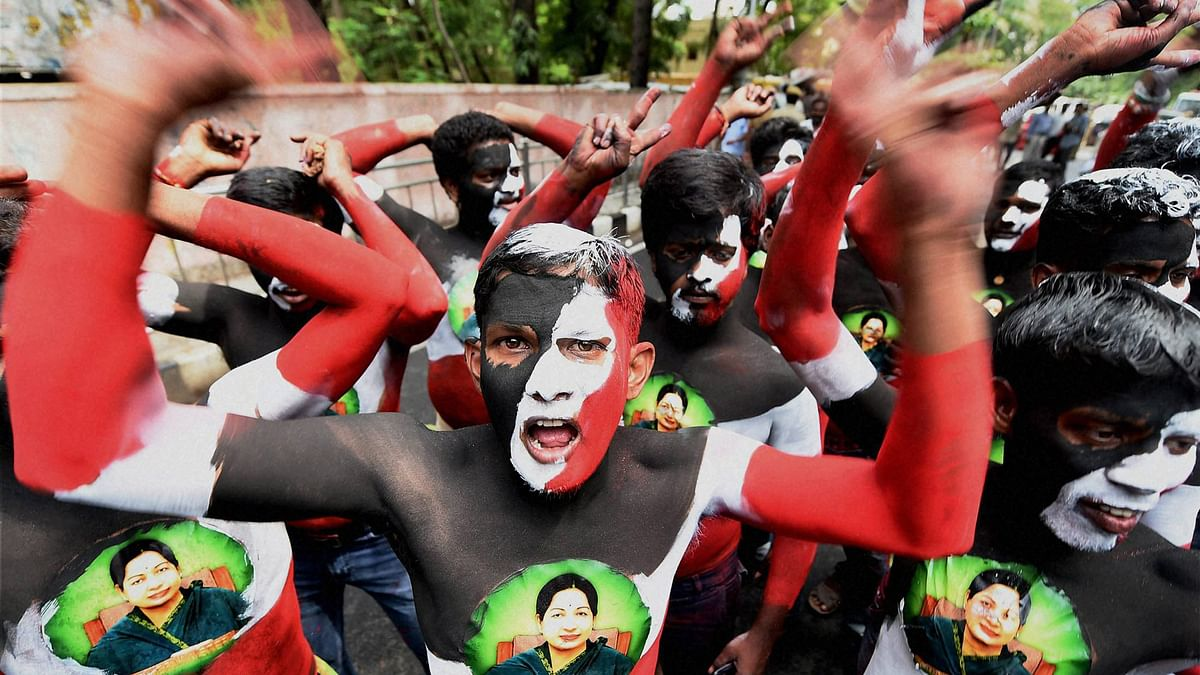 AIADMK cadres, with their bodies painted, celebrate the party's victory  outside Chief Minister J Jayalalithaa's Poes Garden residence in Chennai on Thursday. (Photo: PTI)