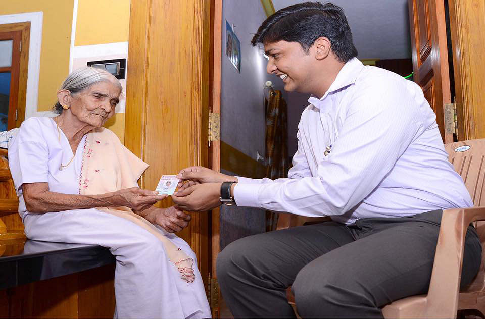 """Thressiama receiving her voter identity card. (Photo: Collector Kannur's <a href=""""https://www.facebook.com/collectorkannur/photos/pcb.992254920871362/992253394204848/?type=3&amp;theater"""">Facebook page</a>)"""