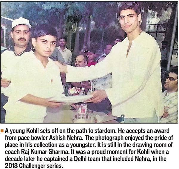 "Photograph of Kohli receiving an award that hangs in the drawing room of coach Rajkumar Sharma. (Photo Courtesy: <a href=""https://www.facebook.com/virat.kohli/photos/a.335662633187513.79505.326546224099154/785026804917758/?type=3&amp;theater"">Facebook/Virat Kohli</a>)"
