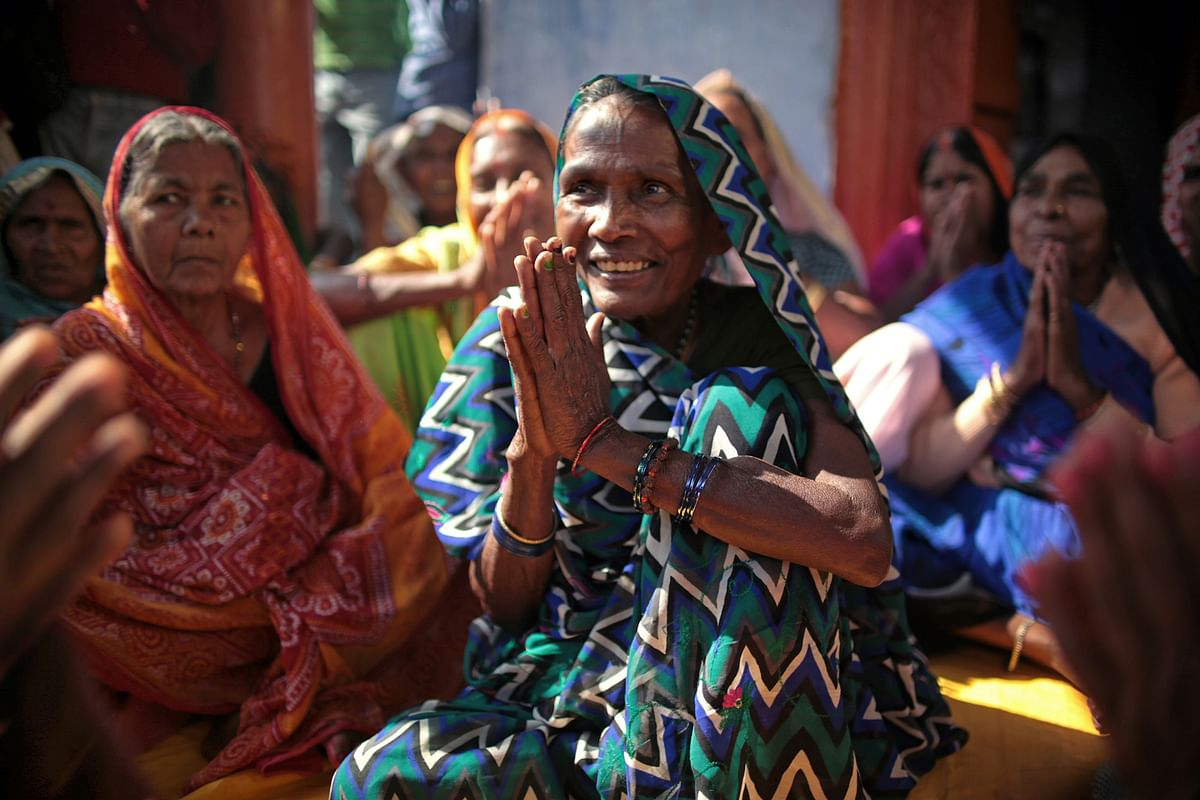 Every Monday in the village of Joni, Sasarem, Bihar, female devotees who have dedicated themselves to the God Shiva perform songs at a local temple.  (Photo: Souvid Datta)