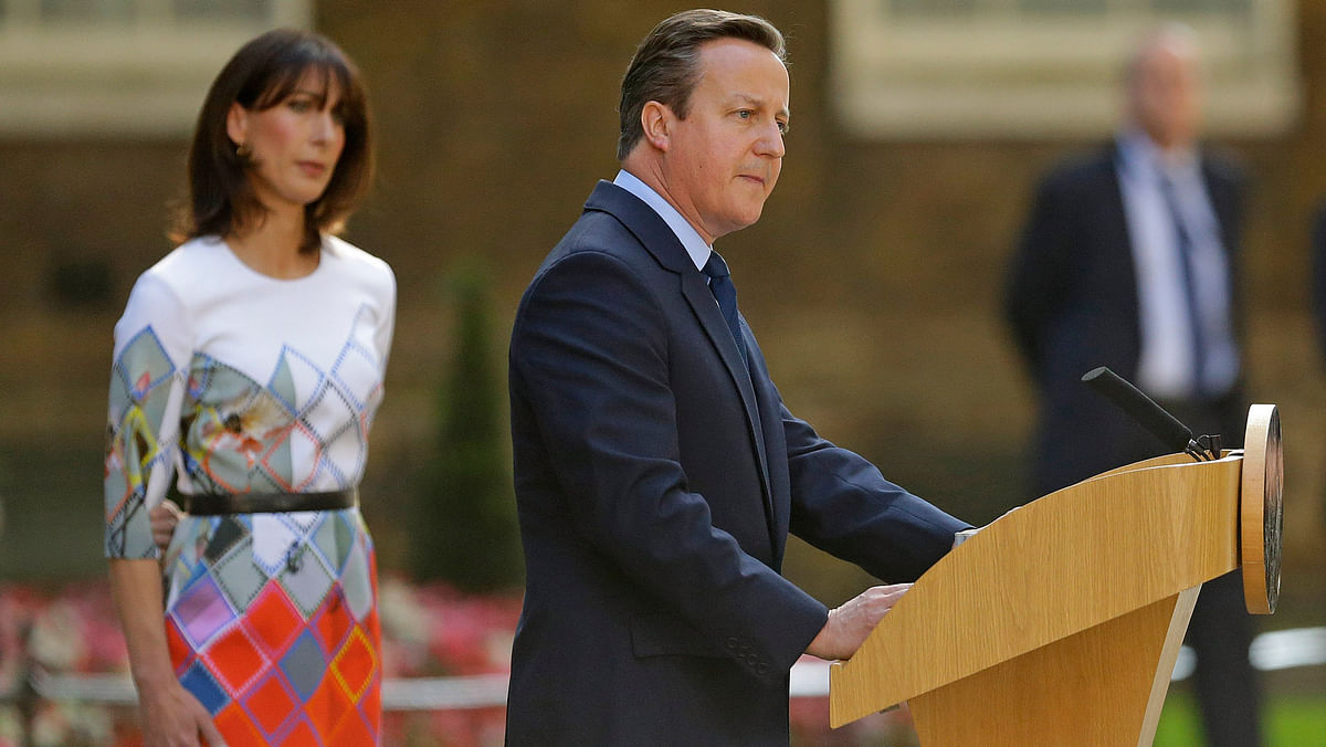 Britain's Prime Minister David Cameron speaks outside 10 Downing Street, London as his wife Samantha looks on Friday, June 24, 2016. (Photo: AP)