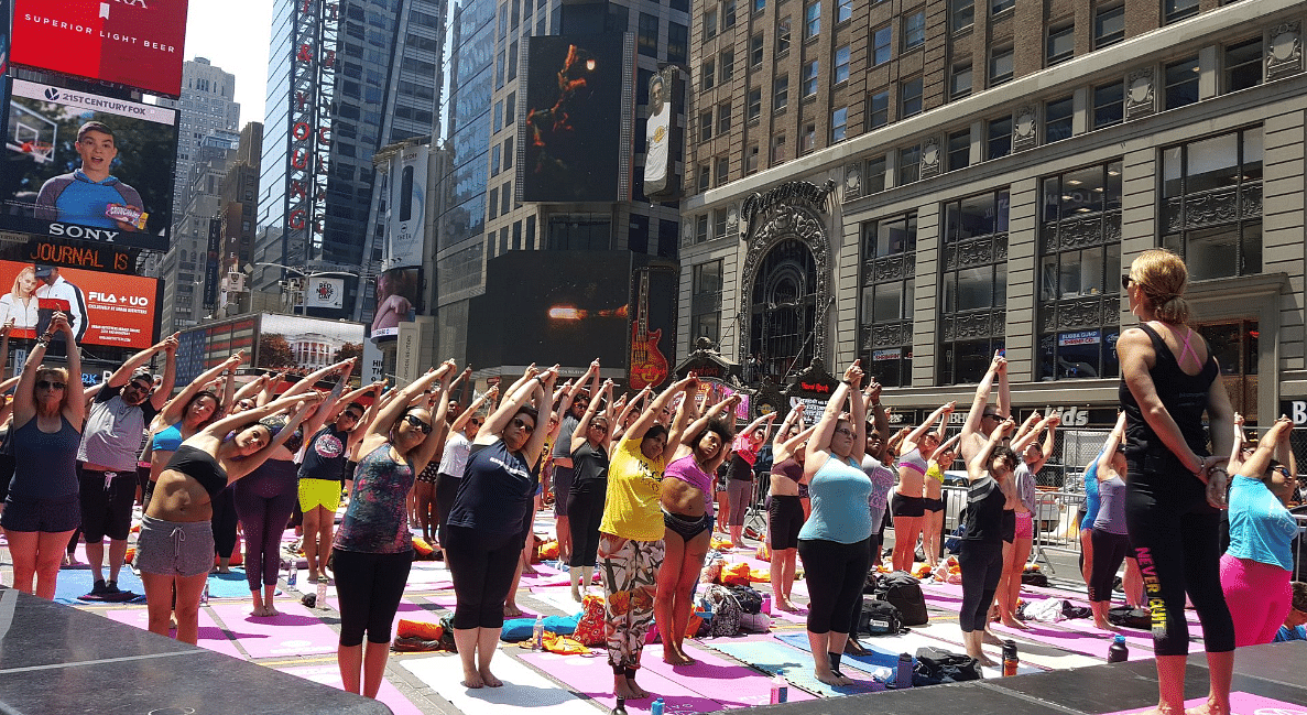 "Times Square London is filled with people doing yoga. (Photo Courtesy: Twitter/<a href=""https://twitter.com/TimesSquareNYC"">Times Square</a>)"