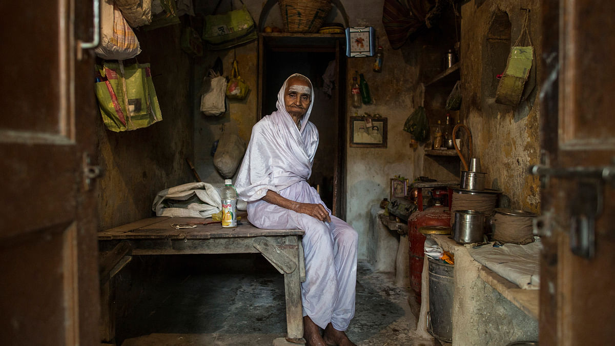 Savitri, an 80-year-old widow, poses for a photograph inside her room at Mumukshu Bhavan (Home of the Ailing) in Varanasi. (Photo: Reuters)