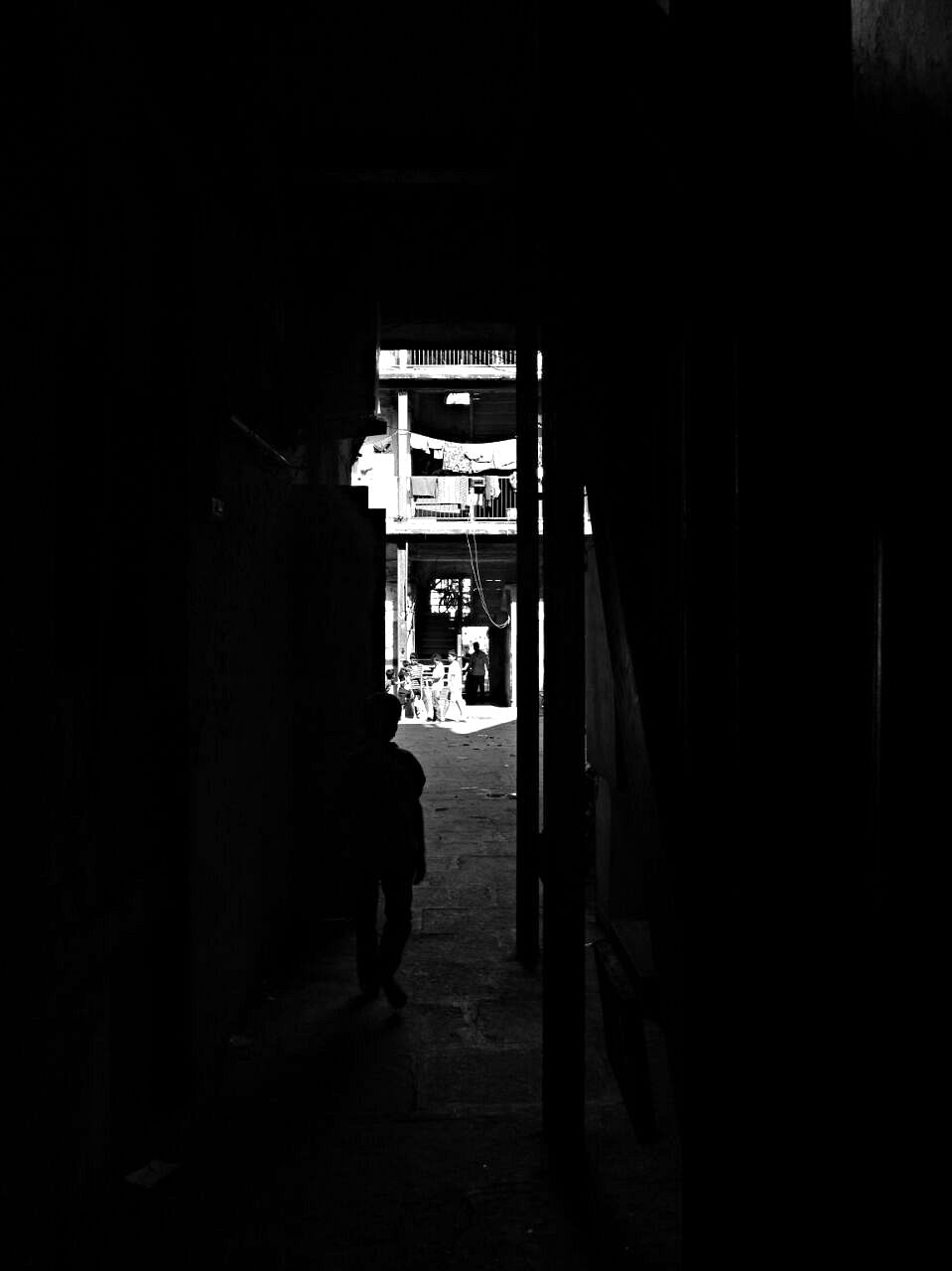A boy running out to a sunny world, out of the shadows of his home. Although attached to the protection of the shadows, he is also raring  for the heat on his skin. (Photo: <b>The Quint</b>/Maanvi)