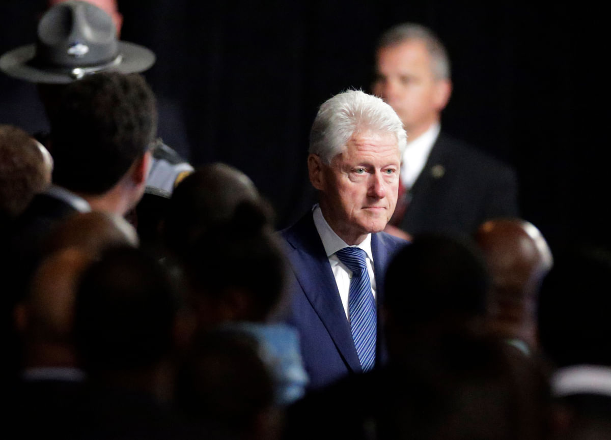 Former President Bill Clinton arrives to give the eulogy at Muhammad Ali's memorial service, Friday, June 10, 2016, in Louisville, Ky. (AP Photo/David Goldman)