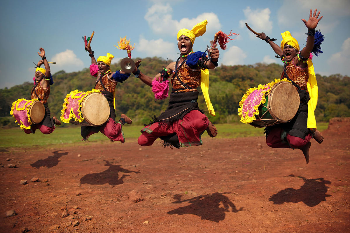 Dancers of the Dollu Kunitha tradition jump in a final climax to their performance.  (Photo: Souvid Datta)