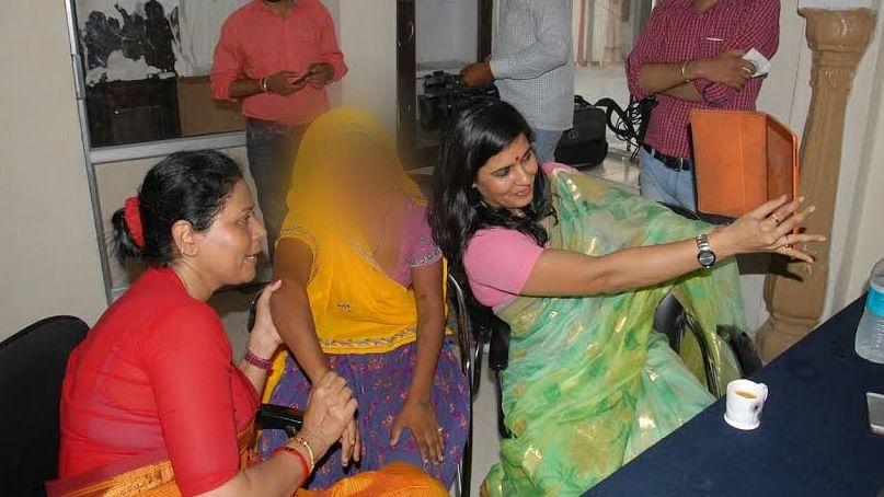 State Commission for Women member Somya Gurjar takes selfie with an alleged rape survivor. (Photo: Twitter @ANI_news)