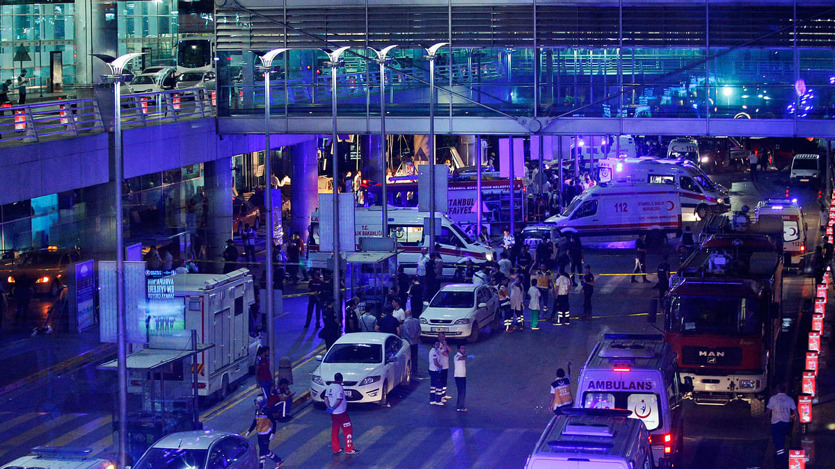 Ambulances and security personnel outside the Istanbul airport. (Photo: AP)