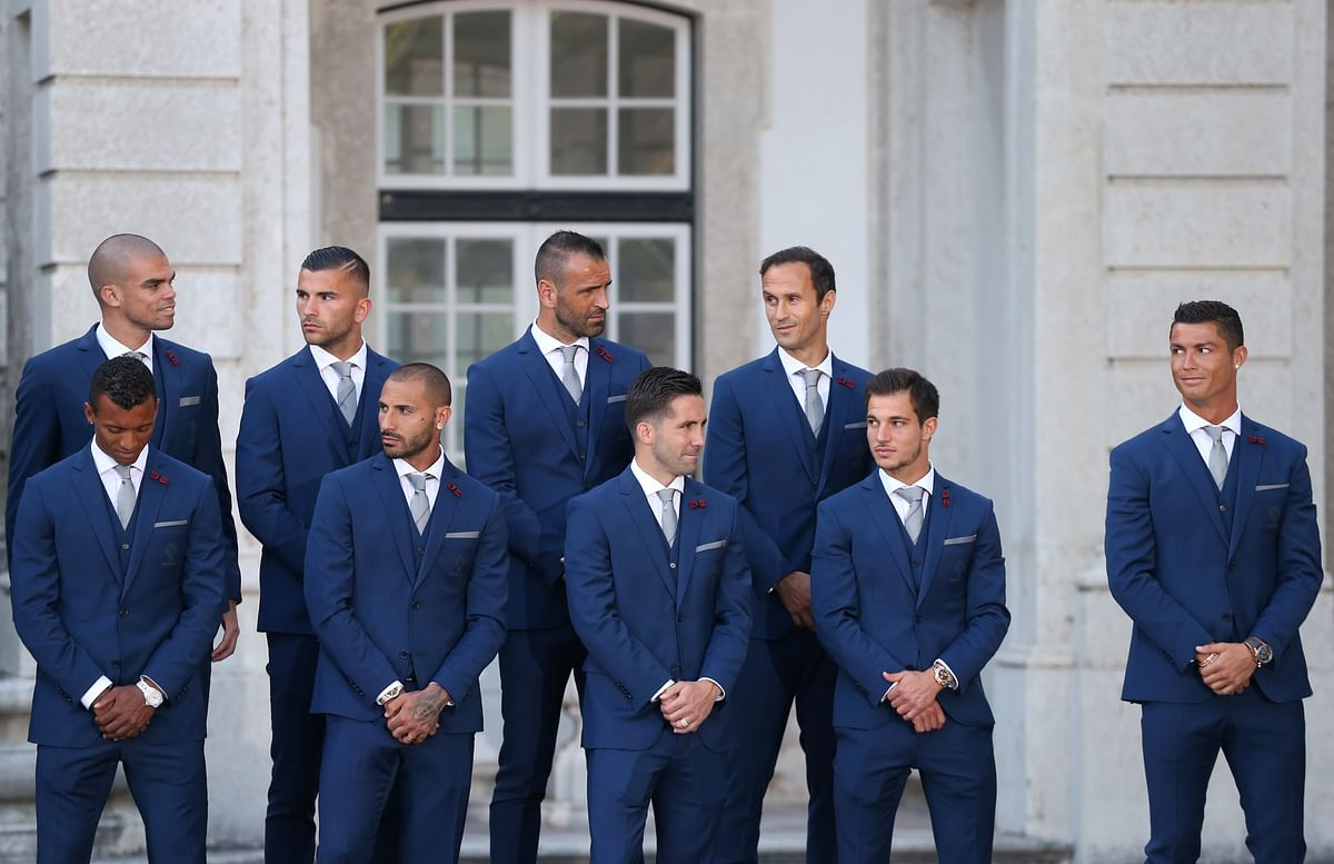 Team captain Cristiano Ronaldo, (right), looks at his teammates while listening to Portuguese President Marcelo Rebelo de Sousa at the Belem presidential palace in Lisbon. (Photo: AP)