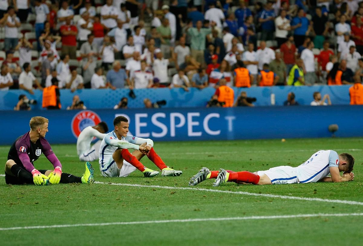 England players react at the end of the Euro 2016 round of 16 match between England and Iceland. (Photo: AP)