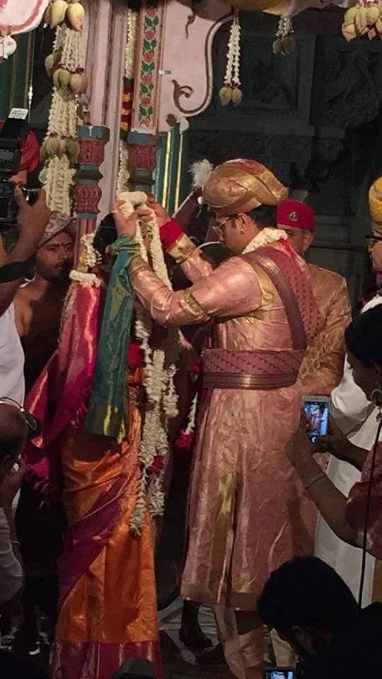 """Bride and groom exchange garlands. (Photo Courtesy: FB Page of <a href=""""https://www.facebook.com/yaduveerkcwadiyar/?fref=ts"""">Yaduveer Krishnadatta Chamaraja Wadiyar- The New scion</a>)"""