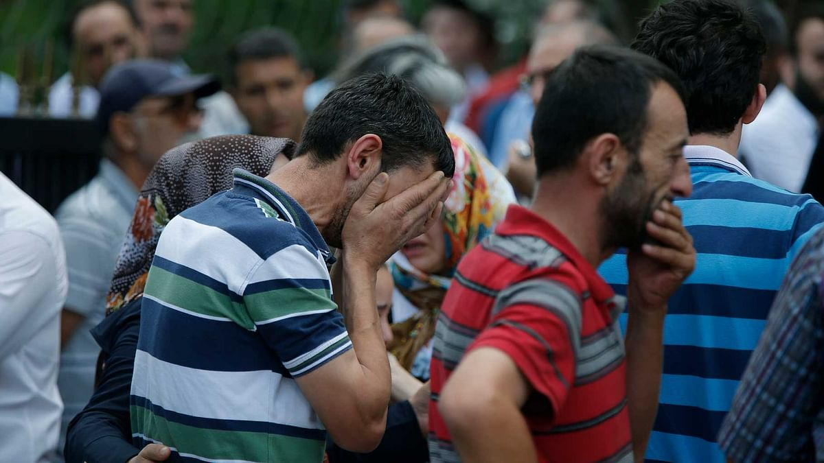 Family members of victims cry outside the Forensic Medical Center in Istanbul. (Photo: AP)