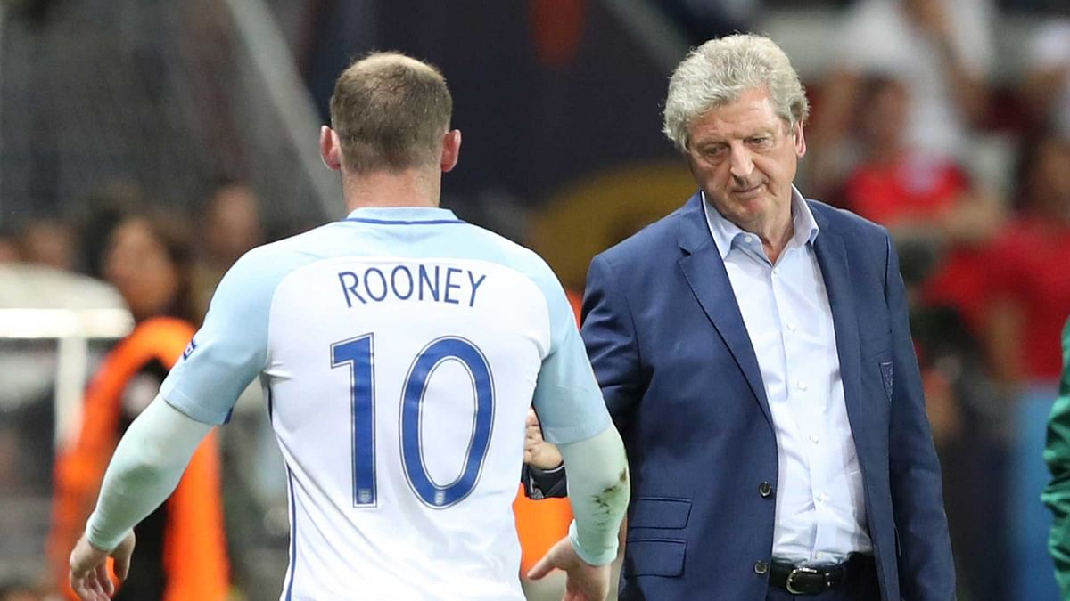 England coach Roy Hodgson meets Wayne Rooney as he leaves the pitch to be replaced during the Euro 2016 round of 16 soccer match between England and Iceland (Photo: AP)