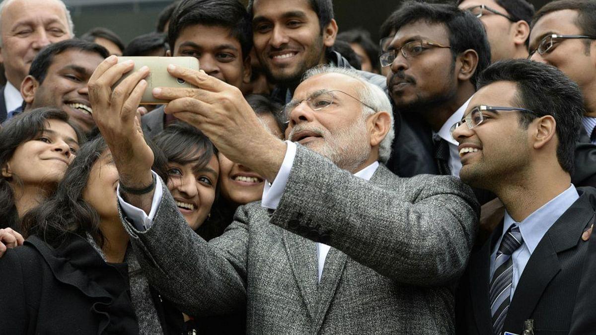 "File photo: Prime Minister Narendra Modi clicks a selfie. (Photo Courtesy: Twitter/<a href=""https://twitter.com/Kractivist/status/673036267492274176"">@Kractivisit</a>)"