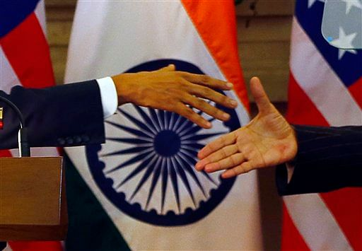 In this 25 January, 2015 file photo, U.S. President Barack Obama (left) and Indian Prime Minister Narendra Modi  shake  hands after they jointly addressed the media in New Delhi, India. (Photo: AP)