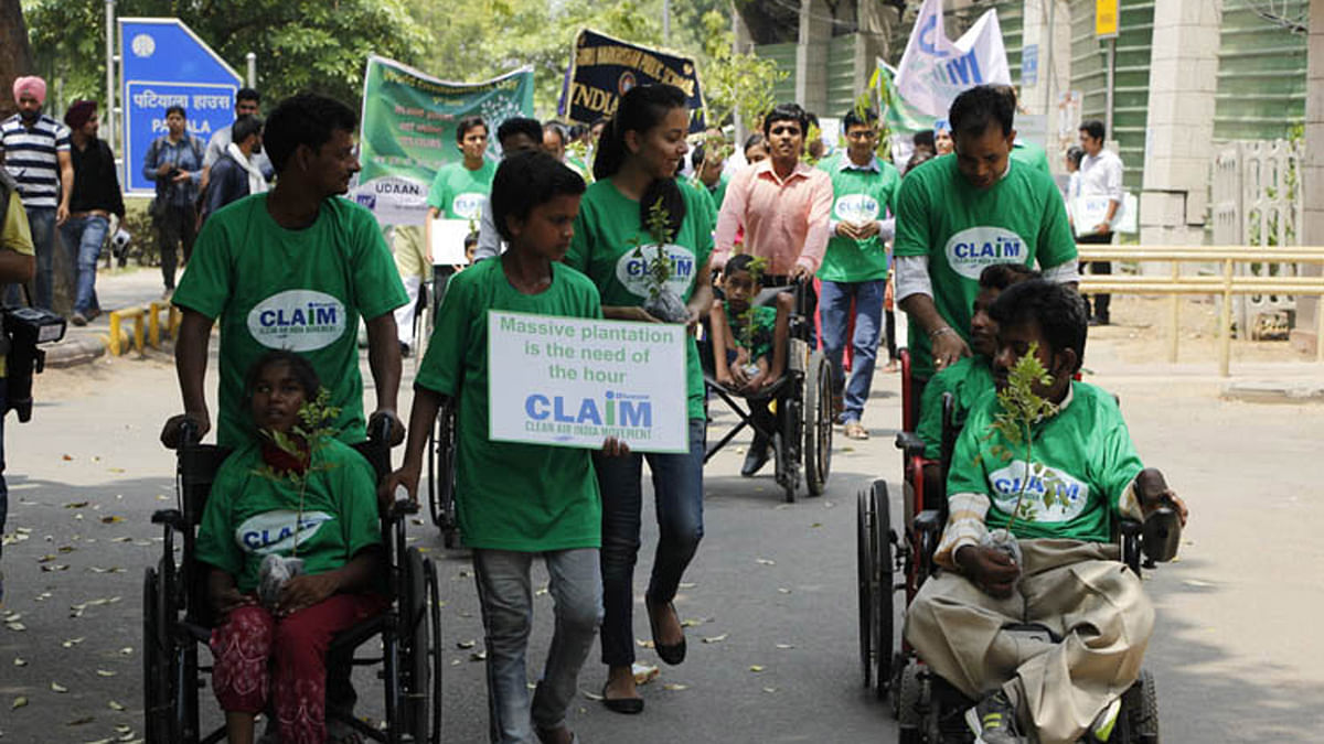 Differently abled students participating in a plantation drive on the occasion of World Environment Day. (Photo: IANS)