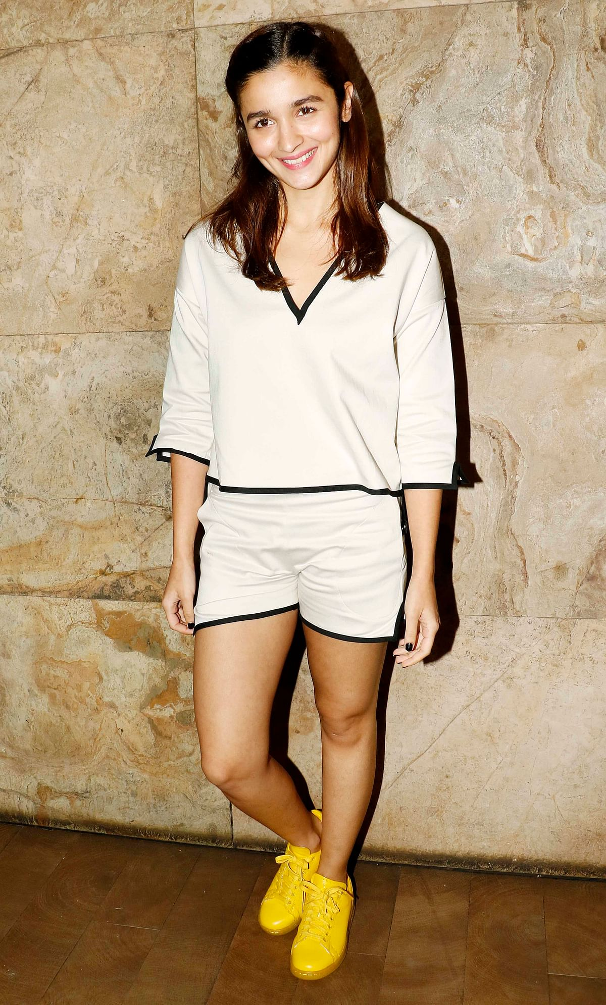 Alia gives the classic black and white a hot twist in this flowy top and shorts. And we can't even begin to talk about those sunshine shoes (Photo: Yogen Shah)