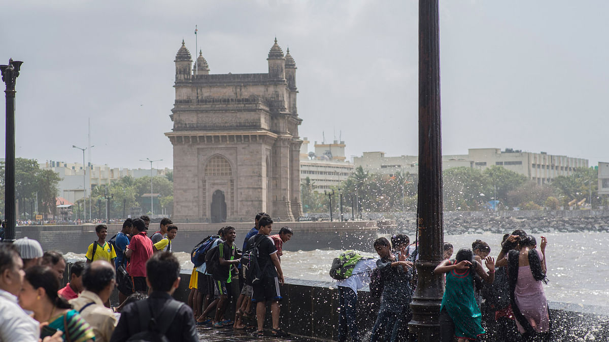 People enjoying  rain near the Gateway of India. (Photo: iStockphoto)