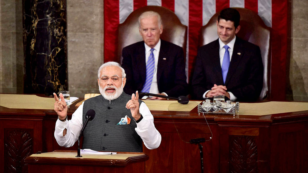Prime Minister Narendra Modi gestures while addressing a joint meeting of Congress on Capitol Hill in Washington on Wednesday. Vice President Joe Biden and House Speaker Paul D. Ryan are seen at the behind. (Photo: PTI)