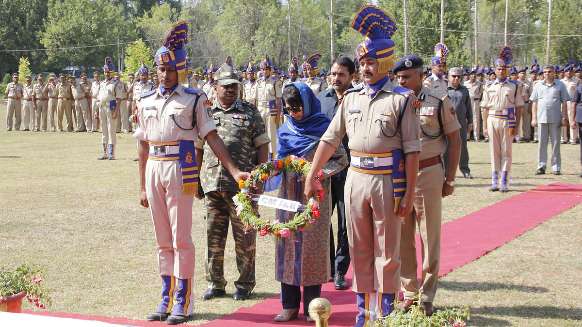 Jammu & Kashmir Chief Minister Mehbooba Mufti lays wreath at the coffins of CRPF martyrs. (Photo: IANS)