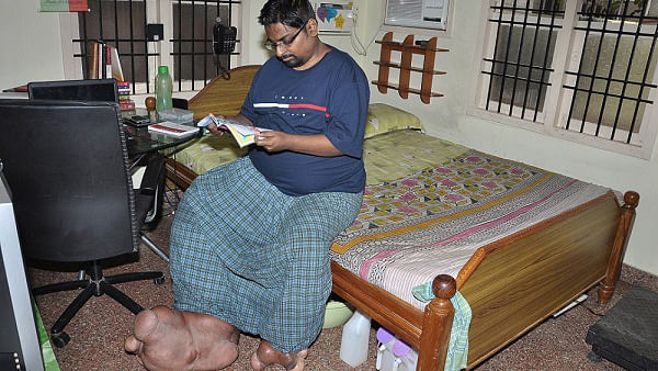Arun Rajasingh in his home. (Photo: <i>The News Minute</i>)
